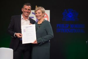 Véronique Goy handing over the Global Certificate to Charles Bendotti, PMI